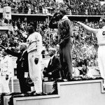 Jesse Owens on the podium at the 1936 Summer Olympics