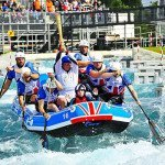 Olympic torch travelling through a canoe