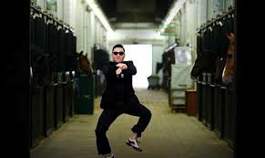 PSY performs the horse riding dance