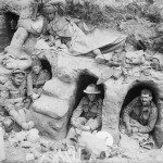 Soldiers resting in shallow dugouts during the Somme Offensive