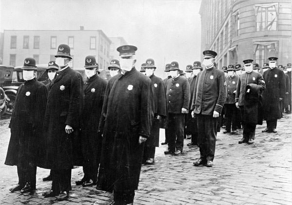 Policemen wearing masks provided by the American Red Cross in Seattle, 1918