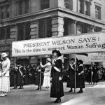 Women suffragists march