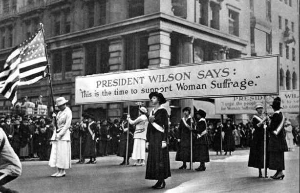 Women suffragists march
