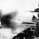 Battleship USS New York firing its 14 in main guns on Iwo Jima