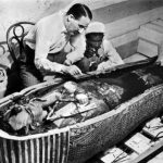 Howard Carter with Tutankhamun's mummy