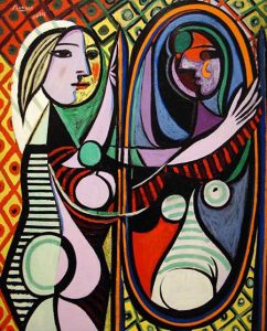 Girl Before A Mirror (1932) - Pablo Picasso