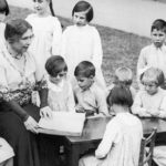 Helen Keller reading to blind children
