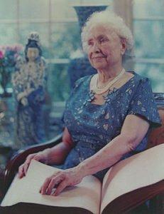 Helen Keller reading a braille book