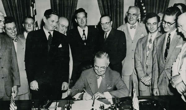 President Truman signing the Housing Act of 1949