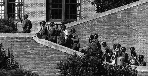 Little Rock Nine being escorted by US army