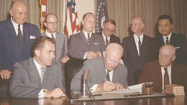 President Eisenhower signs the Hawaii Admission Act of 1959