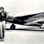 Amelia Earhart in front of Lockheed Electra