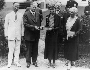 Herbert Hoover presenting the National Geographic Society gold medal to Amelia Earhart