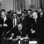 Lyndon B. Johnson signs the Civil Rights Act of 1964