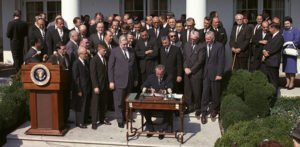 President Johnson signs the Economic Opportunity Act of 1964