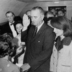 Lyndon B. Johnson taking the oath of office