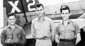 George H.W. Bush (center) as pilot of the United States Navy