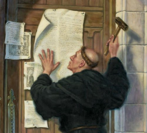 Martin Luther nailing his 95 Theses