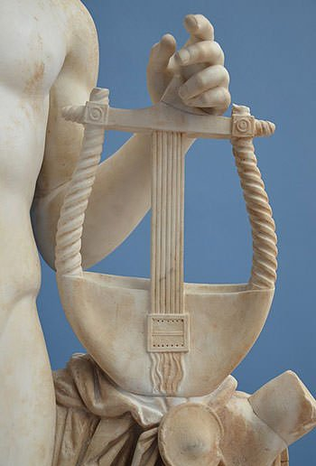 Apollo holding the lyre