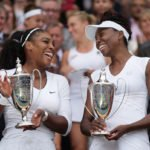 Serena and Venus Williams with Wimbledon doubles trophies