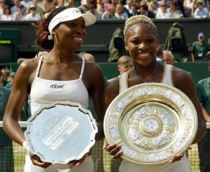 Serena and Venus Williams with Wimbledon trophies