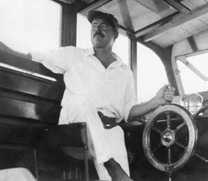 Hemingway on his boat Pilar